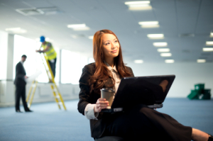 young businesswoman in empty office