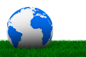 globe on grass. Isolated 3D image